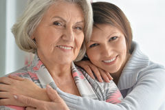 Cheerful Mother And Adult Daughter Royalty Free Stock Photos