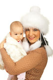 Cheerful mother and baby in fur clothing Stock Image