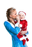Cheerful mother and baby posing in fancy costumes Stock Photo