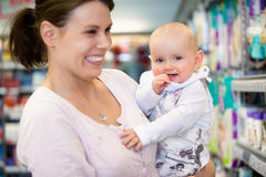 Cheerful mother and baby in shopping centre Royalty Free Stock Images