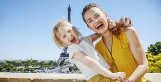Cheerful mother and child hugging while in Paris, France Royalty Free Stock Photography
