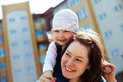 Cheerful mother and curly baby girl Stock Photography