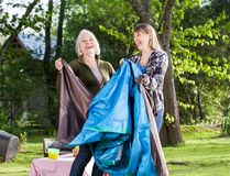 Cheerful Mother And Daughter Assembling Tent In Royalty Free Stock Photo