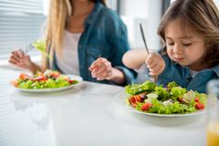 Friendly family tasting healthy food royalty free stock images
