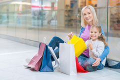 Cheerful mother and daughter having shopping Stock Images
