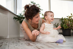 Cheerful mother and daughter are playing around Royalty Free Stock Photography