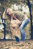 Cheerful mother with her daughter outdoor. stock photos