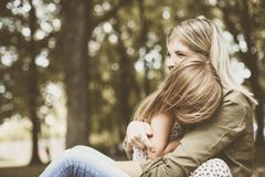Cheerful mother with her daughter outdoor. royalty free stock photo