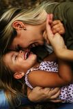 Cheerful mother with her daughter outdoor. stock photography
