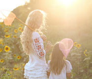 Cheerful mother and her daughter in summer evening Stock Image