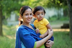 Free Cheerful Mother Holding Infant,close Up Stock Images - 137895714