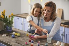 Delighted mum and child cooking easter food royalty free stock photos
