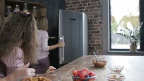 Cheerful mother offering daughter homemade cookies stock video footage