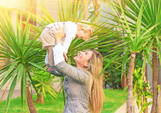 Cheerful mother playing with baby royalty free stock images