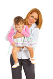Cheerful mother playing with her girl Royalty Free Stock Photo