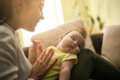 Mother playing with her little girl at home. Close up. stock photo