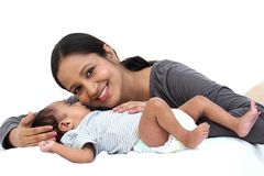 Cheerful mother playing with newborn stock photos