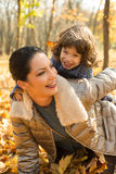 Cheerful mother and son having fun in park Royalty Free Stock Photo