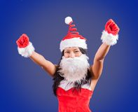 Mrs. Claus raises her hands victoriously up. Cheerful Mrs Claus with her hands up. Mrs. Claus raises her hands victoriously up stock images