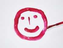 Cheerful mug painted with red lacquer Royalty Free Stock Photos