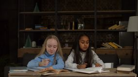 Multiethnic school girls studying together at home stock video