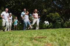 Cheerful multi generation family playing football Stock Image