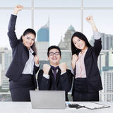 Cheerful multicultural team celebrate success Royalty Free Stock Photography