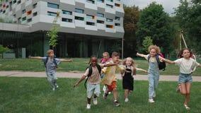 Cheerful multiracial children taking fun on schoolyard