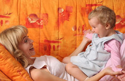 Cheerful mum plays with a daughter Royalty Free Stock Images
