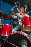 Cheerful musician playing drums Royalty Free Stock Image