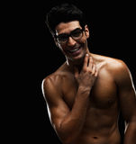 Cheerful naked male wearing spectacles Stock Images