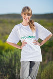 Cheerful natural blonde wearing a volunteering t shirt Royalty Free Stock Image