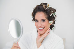 Cheerful natural brunette holding hand mirror Stock Photos