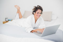 Cheerful natural brunette using laptop Stock Photo