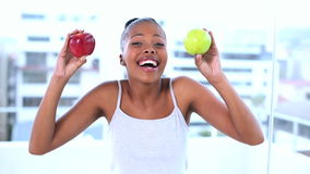 Cheerful natural model holding apples stock video
