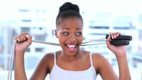 Cheerful natural model holding jump rope Royalty Free Stock Photography