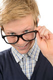 Cheerful nerd boy looking above geek glasses Stock Photography