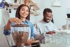 Cheerful new baristas training their coffee-making art Royalty Free Stock Images