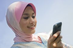 Cheerful with the new mobile phone Stock Photos