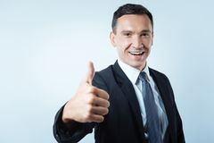 Cheerful nice businessman feeling happy Royalty Free Stock Photos