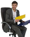 Businessman at office sits in a chair Royalty Free Stock Image