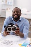 Cheerful nice man using 3d technologies Stock Photo