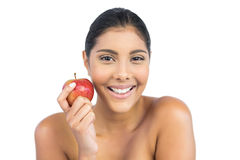 Cheerful nude brunette holding red apple Stock Images