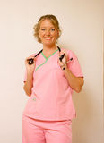 Cheerful Nurse. A happy, cheerful nurse with her stethescope Royalty Free Stock Photos