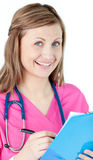 Cheerful nurse with clipboard and pen Royalty Free Stock Image