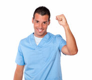 Cheerful nurse man celebrating his victory Royalty Free Stock Images