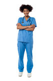 Cheerful nurse posing with arms crossed Royalty Free Stock Images