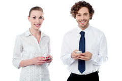 Cheerful office colleagues sending texts Stock Image
