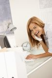 Cheerful office worker on phone call Royalty Free Stock Photos