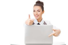 Cheerful office-worker showing thumbs up Royalty Free Stock Photography